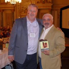 Marc Brière, National President awards a 25-year pin to Cosimo Crupi