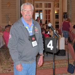 Wayne Barbeau at the Presidents' Conference asking for donations from the participants