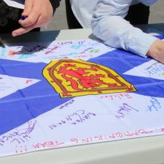 close up of members signing flag