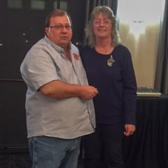 June Martin-Gendron is presented her 10 year pin by RVP Greg Krokosh